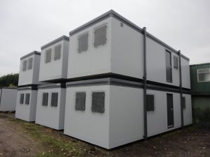 Portable office delivered and stacked - Trading Spaces