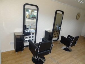 Interior of one of Trading Spaces portable offices convereted to a barbers shop at Asda, Colchester