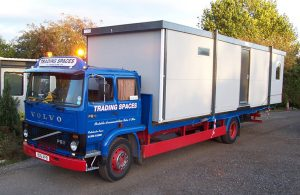 A portable office on the back of a volvo truck ready to be delivered by Trading Spaces Essex